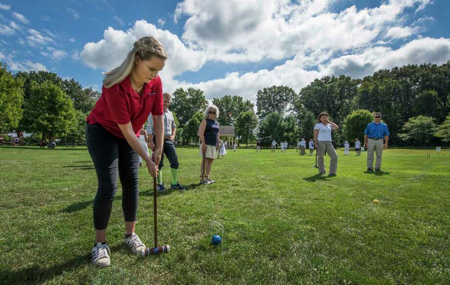 Jaron Marshall of Promenade Senior Living makes a play to get through a wicket while playing a round of croquet at The Crossings at Colonie on Friday, Sept. 14, 2018, in Colonie, N.Y. The event was sponsored by the Colonie Senior Services Centers as a benefit for the Adult Day Programs. (Skip Dickstein/Times Union) Photo: SKIP DICKSTEIN, Albany Times Union / 20044502A