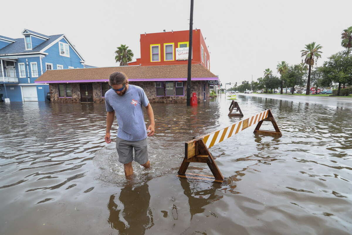 Travis Eifert walks away from the Napalera Galveston restaurant as high water closed the establishment and the street at 50th and Broadway Friday, September 14, 2018 in Galveston.