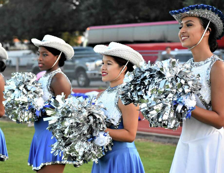 From left are Needville High School Sapphires Dance Team members Kerra Kiser, Mia Rosales and Leyla Mottu, cheering on the varsity football as they take the field for the Friday, Sept. 7, homecoming game. Photo: Needville ISD / Needville ISD