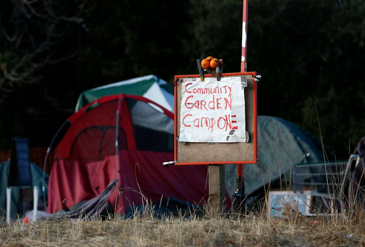A homeless encampment occupies a vacant parcel slated for development at Lake Merritt Boulevard and East 12th Street near the Kaiser Convention Center in Oakland, Calif. on Thursday, Sept. 13, 2018.