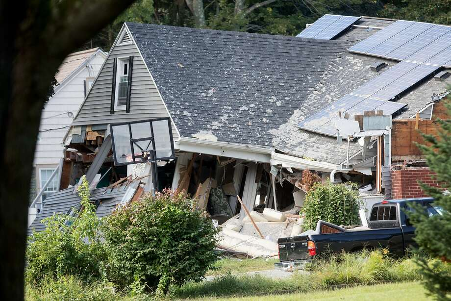 A home in Lawrence, Mass., is one of as many as 80 that were damaged by natural gas explosions in the region on Thursday. One person was killed, while 25 others were hurt. Photo: Scott Eisen / Bloomberg News
