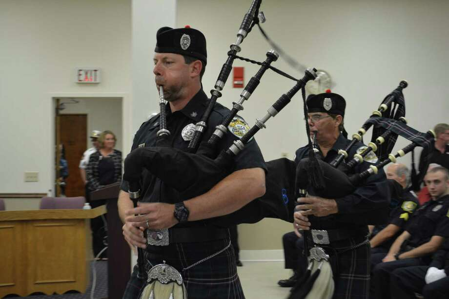 Members of the Waterbury Bagpipers group opened the Winchester Police Department's annual awards ceremony, held Thursday afternoon at town hall. Photo: Leslie Hutchison / Hearst Connecticut Media /