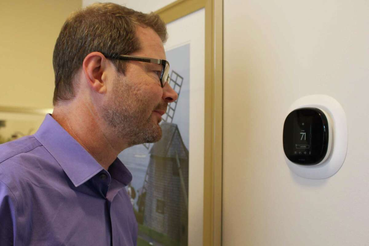 Brian Geyser, Maplewood vice president of clinical innovation and population health, demonstrates a smart apartment's Amazon Alexa thermostat controls