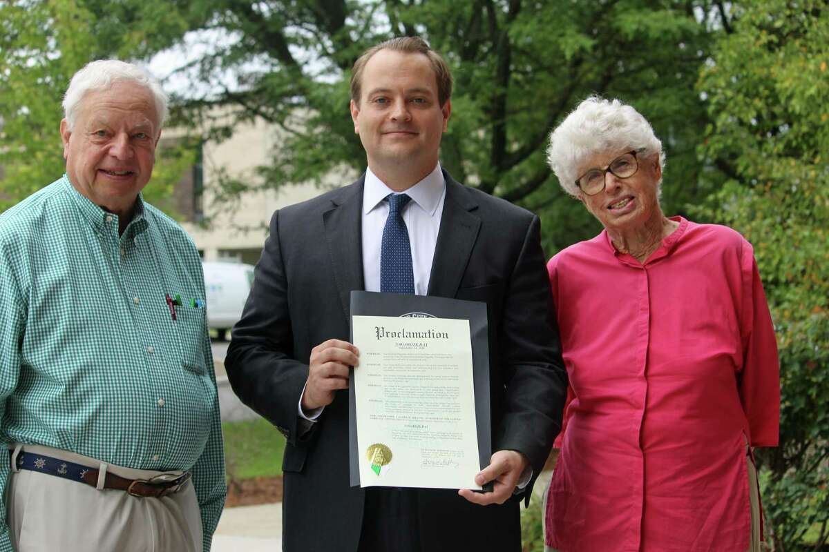 """Councilman Doug Stern holds a """"Proclamation for Nagarote Day,"""" Sept. 14, 2018 outside City Hall in Norwalk, Conn. Beside him are John Woyke, executive director of the Norwalk Nagarote Sister City Project, and Virginia Auster, a founding member of the group."""