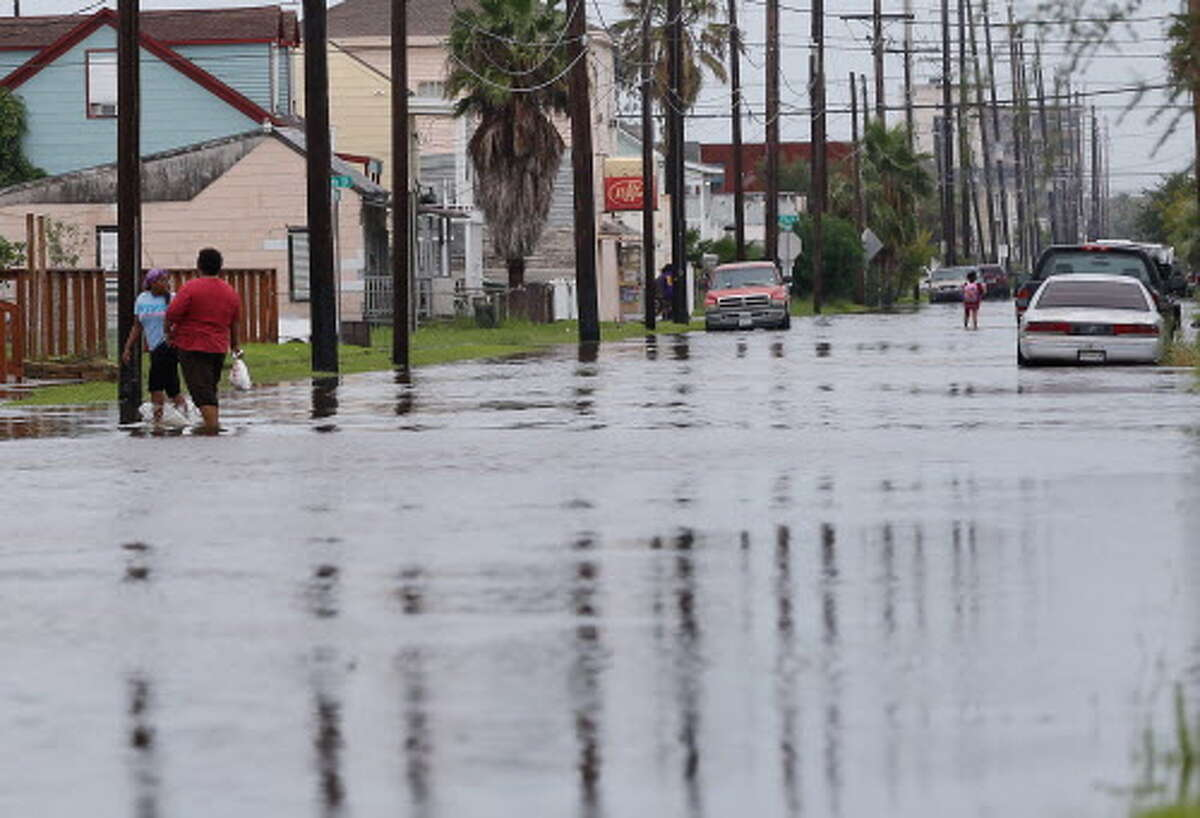 """Location: Jamaica Beach County: Galveston Date: 09/03/2018 Weather Type: Flash Flood Property Damage Amount: $200,000 """"People and vehicles make their way through high water at Ball and Annie Mae Charles Boulevard days after a flash flood hit Jamaica Beach."""" (HoustonChronicle.com)"""