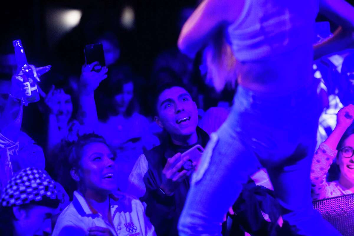 Flavio Farias and Quineyba Farias, left, watch Bad Gyal perform at Slim's on Thursday, Sept. 13, 2018.