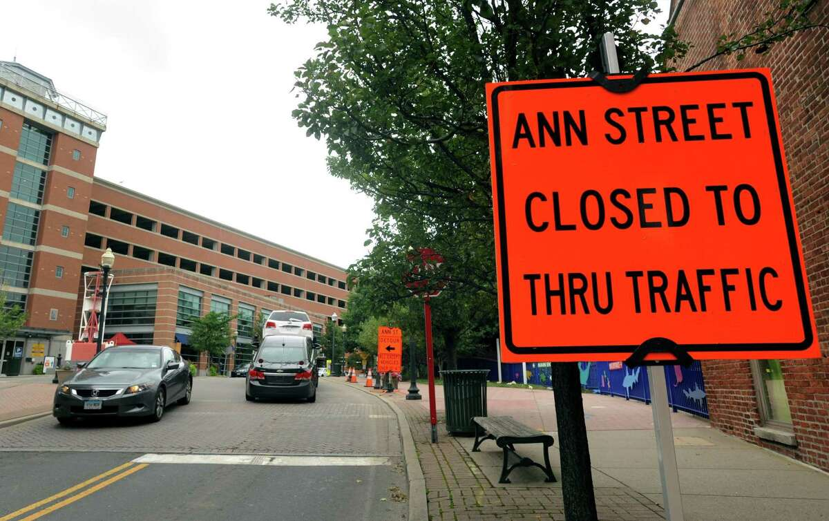 A road closure sign on Ann Street in Norwalk, Conn. in connection with preparations for future work to replace the Walk Bridge over the Norwalk River, with the parking garage of Maritime Aquarium in the background. In September 2018, the home decor retailer Lillian August announced it would not renew its lease on its SoNo annex a few blocks south on Water Street, citing the potential for traffic disruptions.