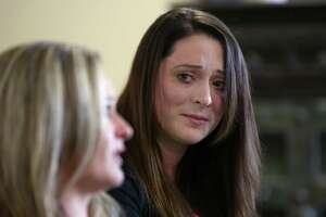 Brie Ana Williams, right, watches her mom, Deana Williams, answer questions during a press conference at the Pinkerton Law Firm about their lawsuit against the Los Vaqueros Trail Ride and the Houston Livestock Show and Rodeo Wednesday, March 22, 2017, in Houston. Brie Ana was brutally attacked at a Los Vaqueros sponsored event. One of the men at raped her remains in jail while the other is out and continues to be involved in the trial ride.( Godofredo A. Vasquez / Houston Chronicle )