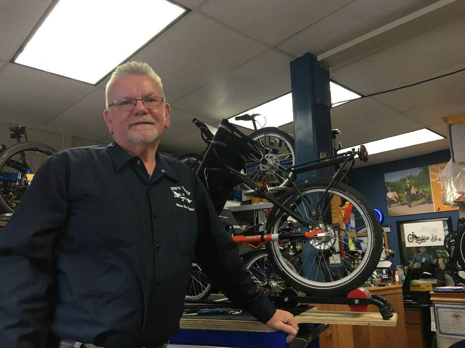 "Bernie ""Spike"" Elwood stands in his shop ""Spike's Trikes"" in Amsterdam, New York on Sept. 14. Elwood, who opened the shop in 2013, sells specialty recumbent tricycles. Photo: Diego Mendoza-Moyers / Times Union"