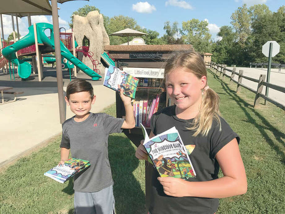 Young author Joby Nelson with and Ivy Obrecht, steward of the Township Park Little Free Library. Photo: For The Telegraph