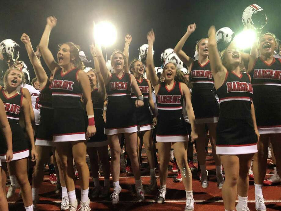 The Hargrave Falcon football players join the Hargrave cheerleaders as they sing the school song in front of their fans following the Falcons' 34-12 victory over the Worthing Colts on September 13 at Butler Stadium Photo: Elliott Lapin / Staff Photo