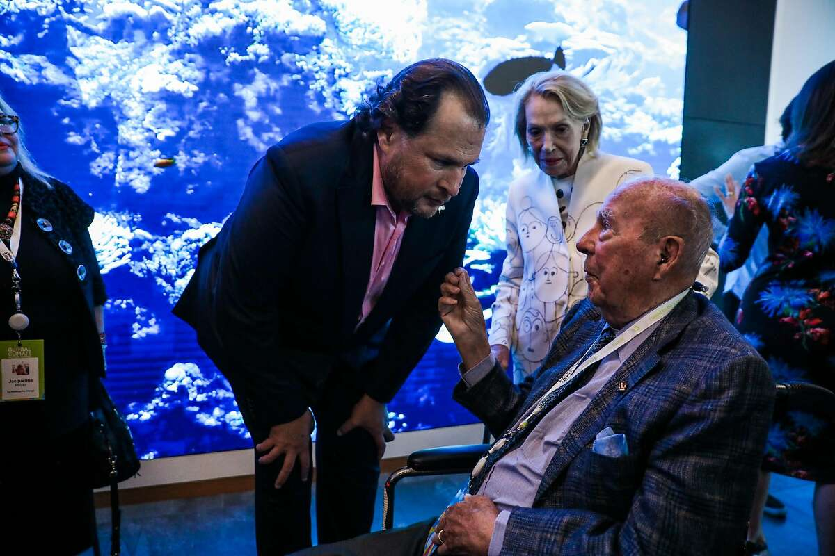Salesforce CEO Marc Benioff chats with former Secretary of State George Shultz (right) at the Healthy Oceans Climate Reception at Salesforce East on Mission Street in San Francisco, California, on Thursday, Sept. 13, 2018.