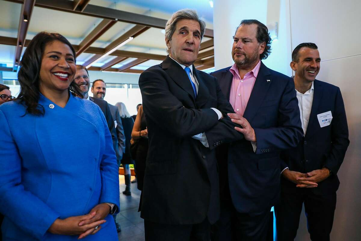Mayor London Breed (left) laughs while Salesforce CEO Marc Benioff jokes with former Secretary of State John Kerry (center) during the Healthy Oceans Climate Reception at Salesforce East on Mission Street in San Francisco, California, on Thursday, Sept. 13, 2018.