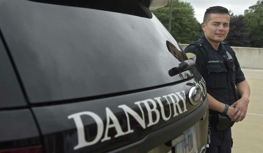 Danbury Police Officer Hector Rodriguez will receive the 2018 American Dream Veteran Award at fifth annual American Dream Awards gala. Rodriguez is a U.S. Army veteran. Thursday September 13, 2018, in Danbury, Conn. Photo: H John Voorhees III / Hearst Connecticut Media / The News-Times
