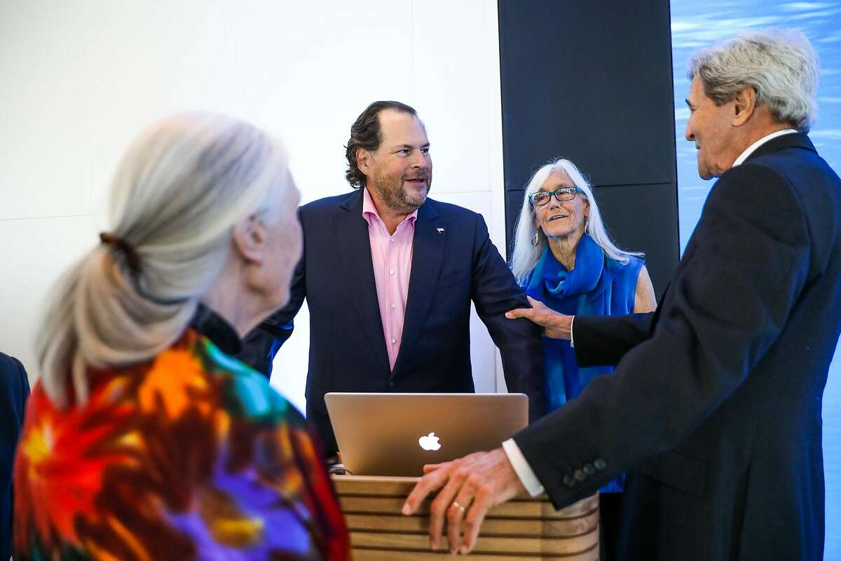 Salesforce CEO Marc Benioff (center) mingles with former Secretary of State John Kerry (right) Julie Packard (second from right) and Jane Goodall (left) at the Healthy Oceans Climate Reception at Salesforce East on Mission Street in San Francisco, California, on Thursday, Sept. 13, 2018.