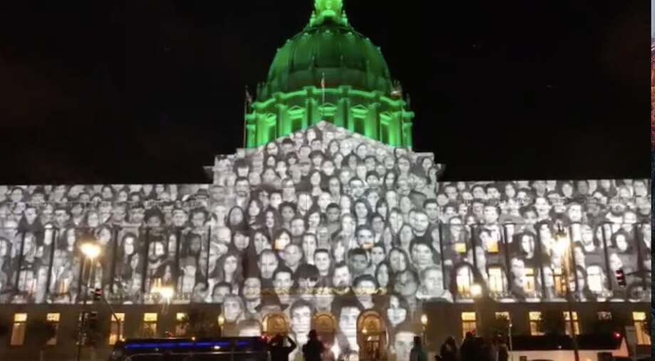 Five hundred faces illuminated San Francisco City Hall this week as part of the Global Climate Action Summit. Photo: Jeff F.
