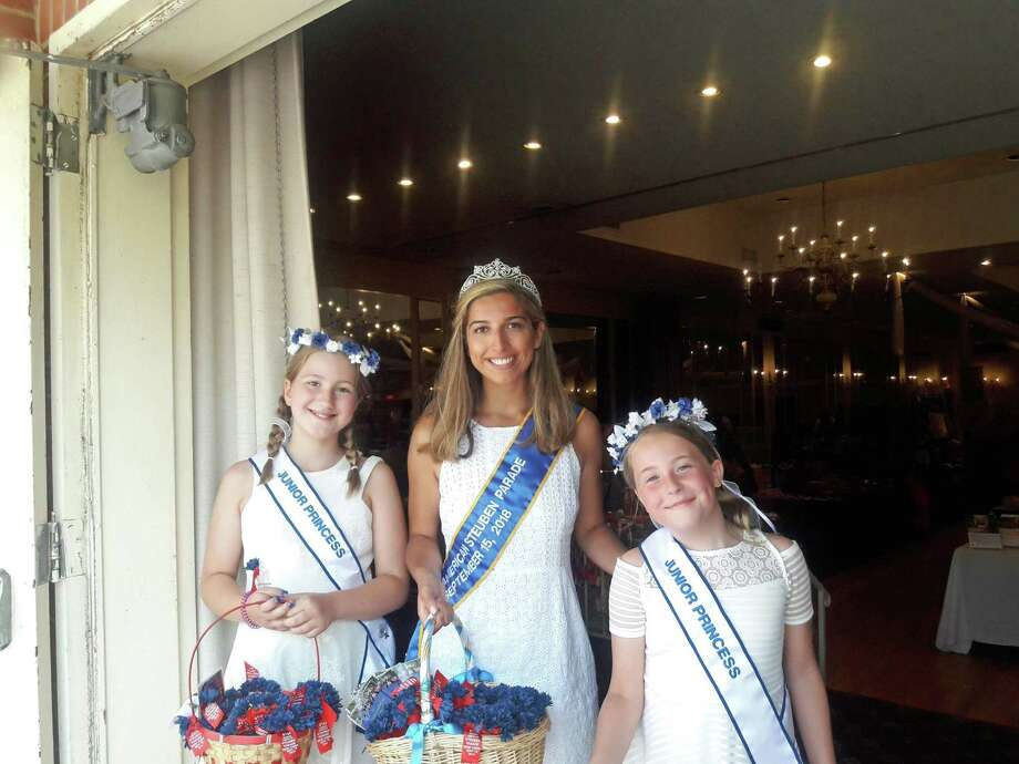 Pavlina Schriel, 23, middle, stands with her two junior princesses, Amelia-Elsa Schweizer (left) and Katherine Husveth-Larsen (right) at Plattduetsch Park in Long Island July 14. The three will lead a march at the German-American Steuben Parade in New York City on Saturday. Photo: Contributed Photo / Contributed Photo / Norwalk Hour contributed