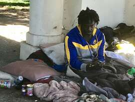 The homeless man identified as Drew has been a regular fixture at Lake Merritt for a couple of years, and gained fame when a jogger tossed his belongings into the water. Oakland officials want to move all the lake's homeless campers into temporary Tuff Shed shelters, but Drew isn't interested.