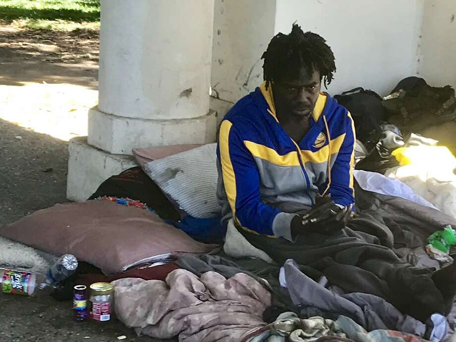 A homeless man known as Drew gained fame when a jogger tossed his belongings into Lake Merritt, but he isn't interested in Oakland's offer of a Tuff Shed as housing. Photo: Andrew Ross / The Chronicle