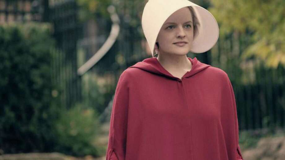 "Elisabeth Moss could win best actress in a drama, while the ""The Handmaid's Tale"" is also favored for best drama. Photo: Hulu, HO / TNS / Los Angeles Times"