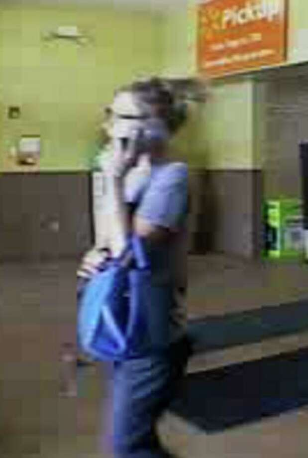 The suspect is a white woman in her 30s, about 5 foot, 4, with a thin build and blonde hair.  She wears glasses and was last seen wearing a purple shirt and blue jeans.