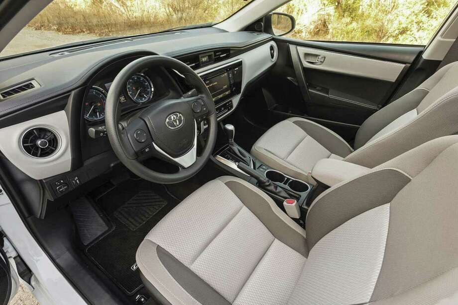 The 2018 Toyota Corolla sedan has ample seating for up to five people, and lots of standard and optional equipment. That includes SofTex faux leather seats on the uplevel XSE model. (Toyota photo)