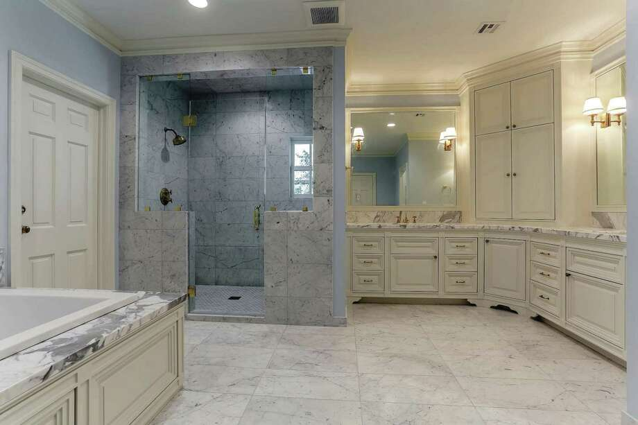 Frameless glass shower doors and custom framed mirrors are good examples of using glass in design.