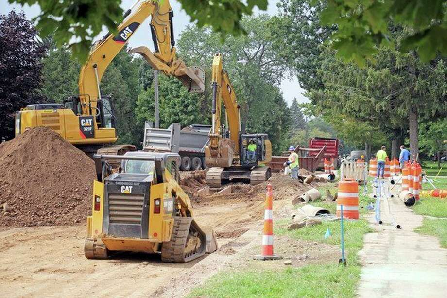 Crews were busy Friday afternoon working on the East Irwin Street project in Bad Axe. (Seth Stapleton/Huron Daily Tribune)