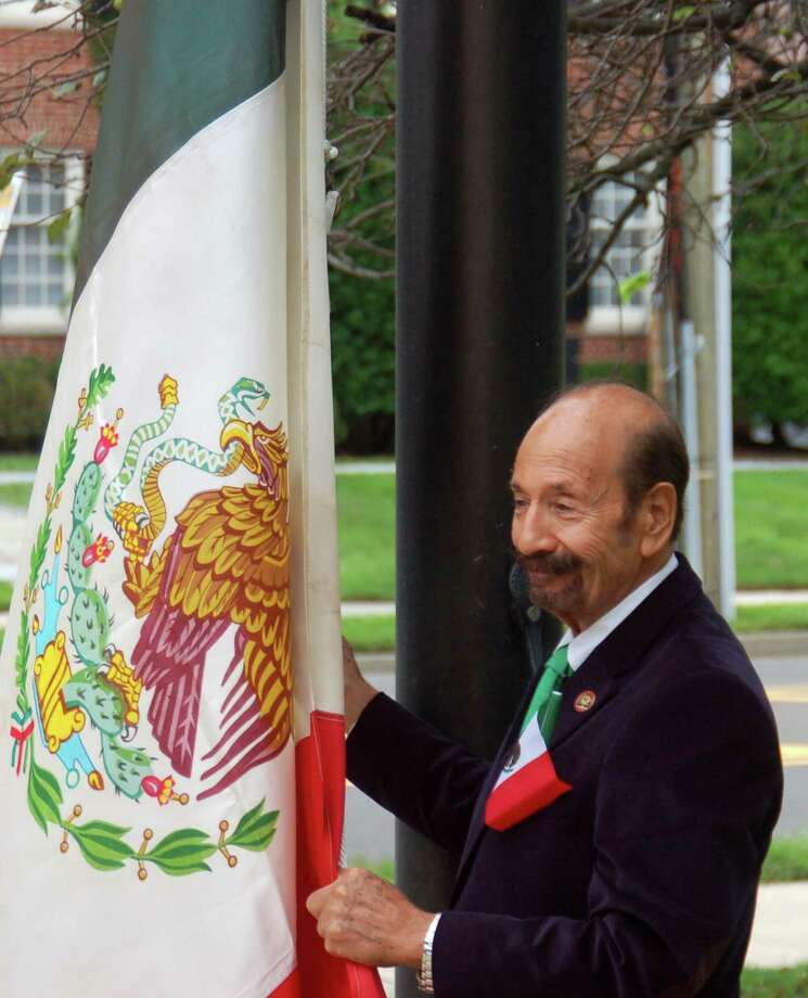 Leoncio Flores-Velazco had the honor of raising the Mexican flag outside Greenwich Town Hall to mark Mexican Independence Day on Friday, September, 14, 2018. Photo: Ken Borsuk / Hearst Connecticut Media / Greenwich Time