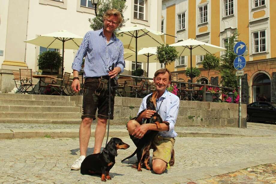 Dackelmuseum owners Oliver Storz, left, and Seppi Kublbeck, with their dachshunds Moni, left, and Little Seppi Photo: Selina Kok, For The Washington Post / For The Washington Post / For The Washington Post