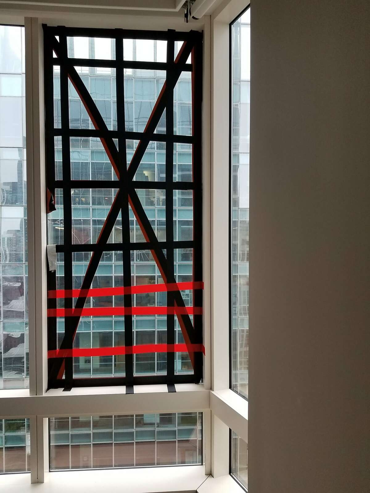 Cracked glass in the Millennium Tower.