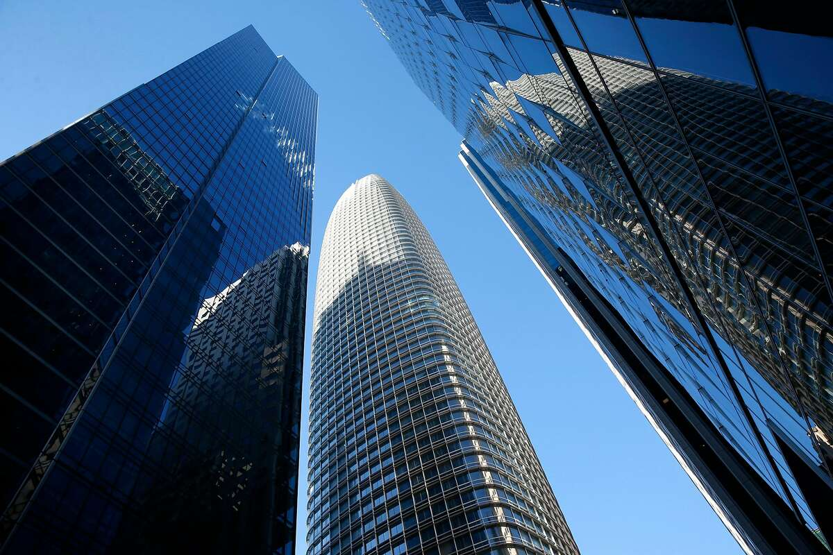 The Millennium Tower (left) is seen next to Salesforce Tower (center) in San Francisco, Calif. on Tuesday, March 27, 2018. Engineers may begin preliminary work soon to stabilize the sinking and leaning Millennium Tower.