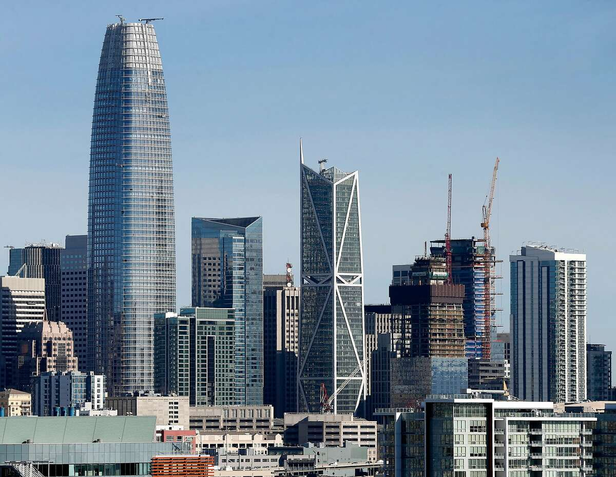 The Millennium Tower building rises between Salesforce Tower and 181 Fremont in San Francisco, Calif. on Tuesday, March 27, 2018. Engineers may begin preliminary work soon to stabilize the sinking and leaning Millennium Tower.