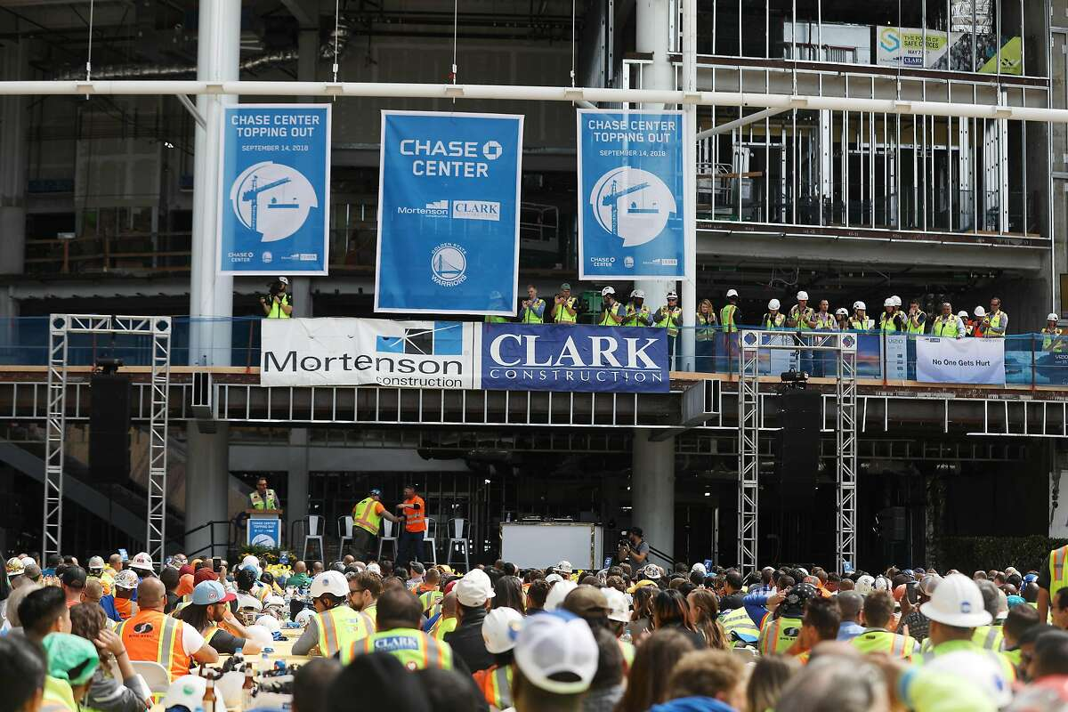 Attendees watch as awards are handed out after the craft workers lunch at the end of the Chase Center topping out celebration on Friday, September 14, 2018 in San Francisco, Calif.