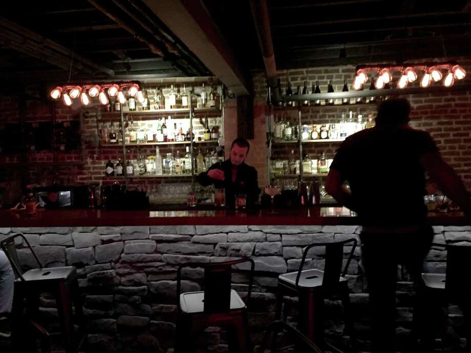 "A promotional video is touting the downtown-adjacent area as a ""6 bar experiences on 1 block."" In the clip, Ash, Ember, Cellar Mixology, Smoke BBQ, Alibis and Lilly's Greenvile, are all shown pouring cocktails, providing live music, billiards and dancing. All of the bars are within walking distance from each other. Photo: Paul Stephen / Staff"