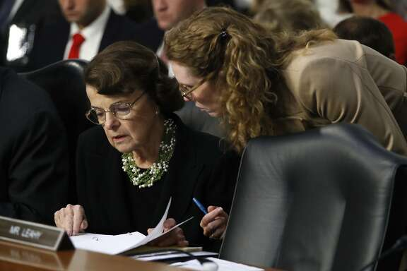 Ranking member Sen. Dianne Feinstein, D-Calif., left, looks over a document during testimony by President Donald Trump's Supreme Court nominee, Brett Kavanaugh, on the third day of Kavanaugh's Senate Judiciary Committee confirmation hearing, Thursday, Sept. 6, 2018, on Capitol Hill in Washington, to replace retired Justice Anthony Kennedy. (AP Photo/Jacquelyn Martin)