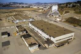 """Aerial photos of Hunters Point Naval Shipyard Building 401 in Parcel G in San Francisco, Calif., on Tuesday, September 11, 2018. The Navy's retesting plan for Parcel G is being brought into question. When the U.S. Navy pledged to perform new soil tests at its Superfund waste site in San Francisco, the priority was """"to protect the human health and the environment."""" But the Navy's re-testing plan is largely based on a cost-cutting report it paid a defense contractor to put together more than six years ago. What's more, the old report relies on data collected by Tetra Tech, the cleanup firm that submitted fake measurements and got caught. It essentially advocates for lowering cleanup standards and leaving more radioactivity in the ground. Multiple government agencies have now come out against the Navy?s plan to re-test Parcel G, saying that it could put public health at risk if it is not changed. Environmental experts agree and say even if the Navy listens to those agencies the plan is flawed and falls far short of what was promised in the wake of the Tetra Tech fraud revelations."""