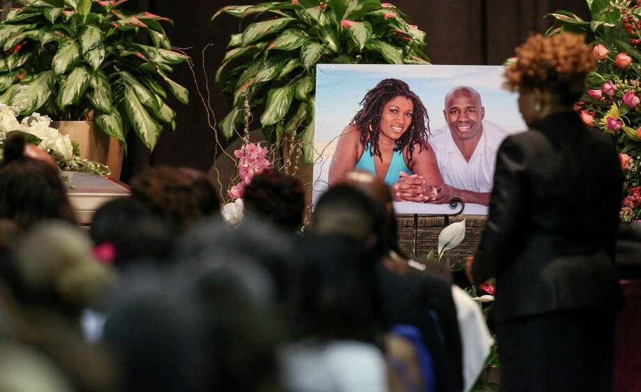 A photo of Dawn Armstrong, left, and her husband Antonio, is seen during a funeral for them, Saturday, Aug. 6, 2016, in Houston. The couple was fatally shot in their home, and their teenage son has been accused of the killings. ( Jon Shapley / Houston Chronicle ) Photo: Jon Shapley, Staff / Houston Chronicle / © 2015  Houston Chronicle