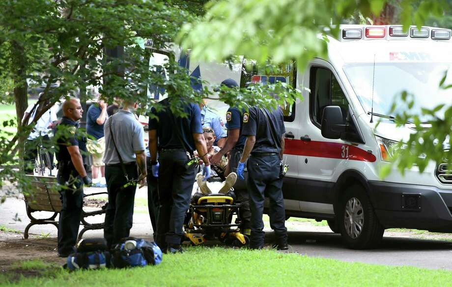 Emergency personnel respond to overdose cases on the New Haven Green in August. Photo: Arnold Gold / Hearst Connecticut Media File / New Haven Register