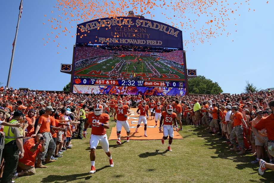 FILE- In this Sept. 7, 2013, file photo, Clemson players run down the hill before the start of an NCAA college football game against South Carolina State at Memorial Stadium in Clemson, S.C. Clemson is moving forward with plans to host its scheduled football game on Saturday while Hurricane Florence wreaks havoc on the Carolinas' coastline with officials bracing for historic flooding and record-setting rainfall that has forced people to evacuate their homes to escape the wrath of the storm. (AP Photo/Richard Shiro, File) Photo: RICHARD SHIRO, Associated Press