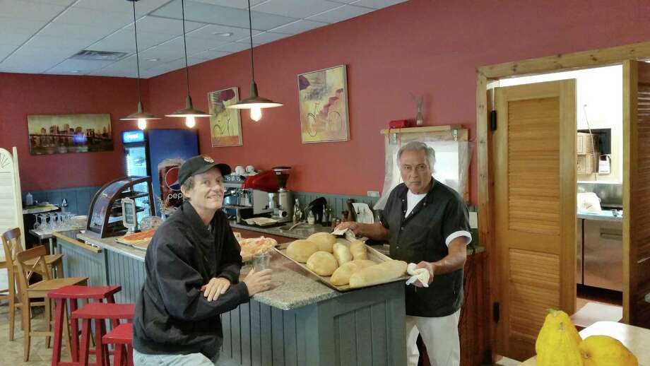 Owner and chef Adriano DiMario shows his freshly baked breads to customer James Claitor, of Sharon, at DiMario's new Italian restaurant, Dining Alfresco, at 10 Gay St. in the Sharon Shopping Center. Photo: NF Ambery / Contributed Photos