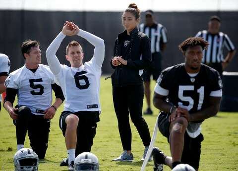 cce34649a2c  p Raiders strength and conditioning assistant coach Kelsey Martinez works  with punter Johnny Townsend