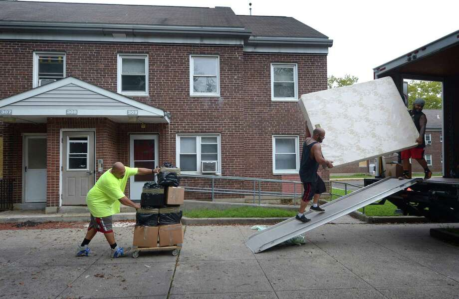 Employees of McCabe Moving remove belongings of tsome of the remaining residents at Washington Village Thursday, September 13, 2018, in Norwalk. Norwalk Housing Authority Executive Director Adam Bovilsky answered questions about remaining Washington Village residents during 'Call to Action …' forum arranged by District B Councilman Ernie Dumas on Thursday evening. Photo: Erik Trautmann / Hearst Connecticut Media / Norwalk Hour