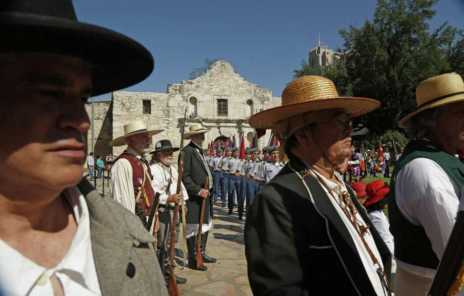While roll call of Alamo Defenders was read, reenactors and others stand at attention April 23. A reader points out that not all defenders were Texans — as in born in Texas. Therefore, the sacrifice was for all Americans. Photo: Ronald Cortes / / 2018 Ronald Cortes