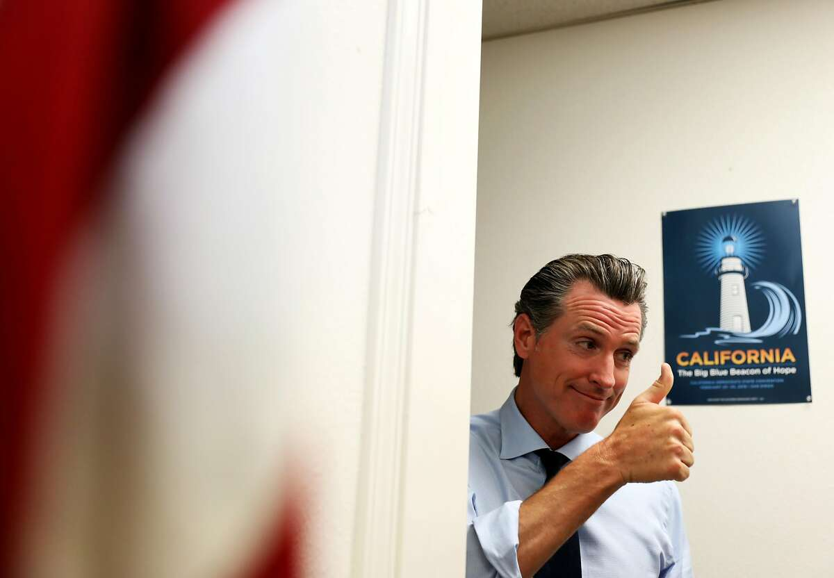 Democrat gubernatorial candidate Gavin Newsom gives a thumbs up as he exits the Fresno Democratic Campaign Headquarters in Fresno, Calif. on Wednesday, September 12, 2018. Newsom campaigned with TJ Cox, a US House candidate, CA-21, and Melissa Hurtado, a candidate for State Senate, SD-14.