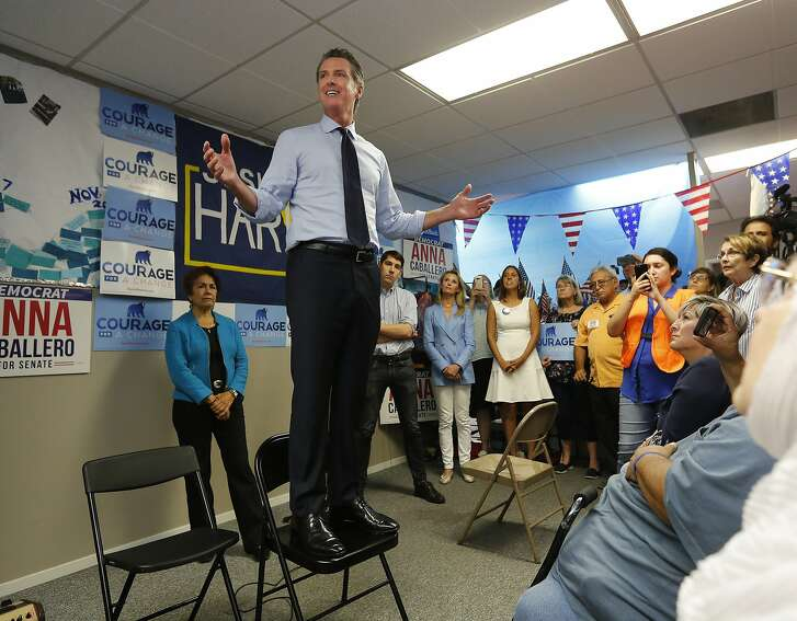 California gubernatorial candidate. Lt. Gov. Gavin Newsom, a Democrat, stands on a chair as he addresses supporters, during a stop Wednesday, Sept. 12, 2018, in Modesto, Calif. Newsom, who is battling Republican John Cox, is traveling the state to lend his support to Democrats running in contested districts. (AP Photo/Rich Pedroncelli)