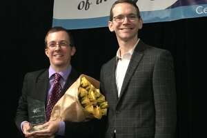 Mike Morath, Texas Commissioner of Education, right, stands next to Texas Teacher of the Year Jeff Wheatcraft of Alamo Heights Junior School.
