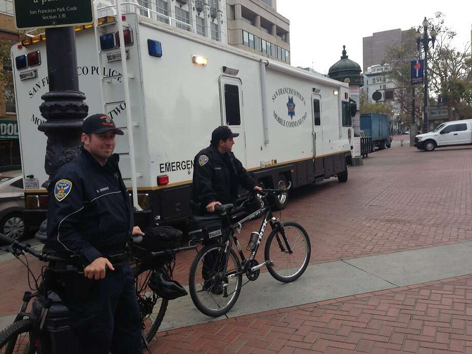 San Francisco police keep watch outside the mobile command station in U.N. Plaza. Photo: Phil Matier / The Chronicle