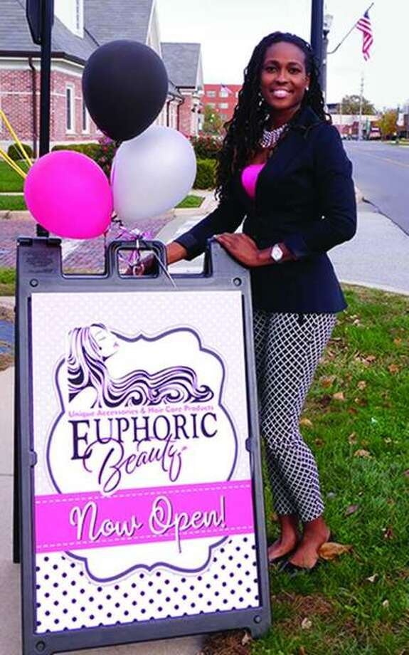In this November 2017 filed photo, Markia Ivy poses outside of her shop, Euphoric Beauty in Edwardsville. She was killed in a July 12 crash and police are investigating if the driver that caused it was distracted by a cell phone.