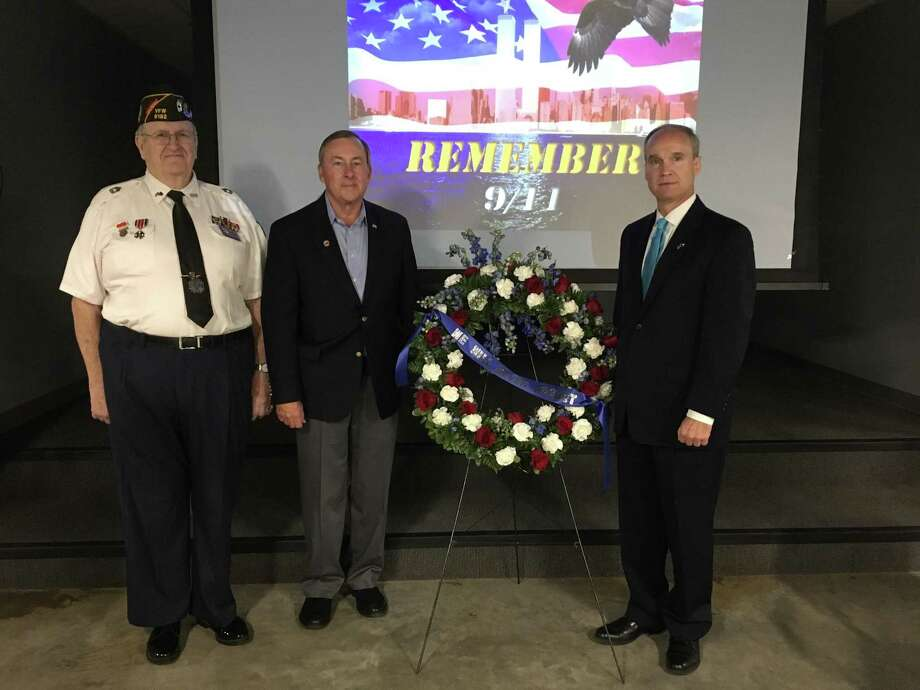Katy VFW Post 9181 concluded its 9/11 Memorial Ceremony with a wreath presentation. From left are: Post Commander Don Bryne, Katy Mayor Chuck Brawner and District 132 state Rep. Mike Schofield, R-Katy. Photo: Karen Zurawski / Karen Zurawski